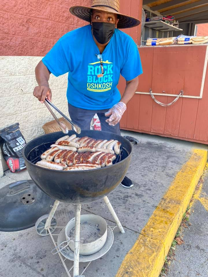 Rodney grilling at a fundraiser event at Festival Foods in Oshkosh